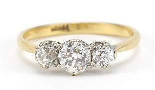 18ct gold diamond trilogy ring, the central diamond
