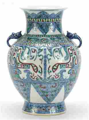 Chinese doucai porcelain vase with handles, hand