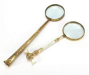 Two large antique gilt metal magnifying glasses
