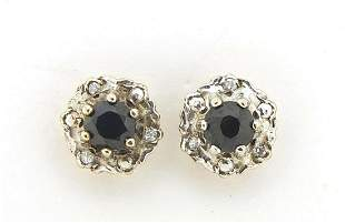 Pair of 9ct gold sapphire and diamond stud earrings,