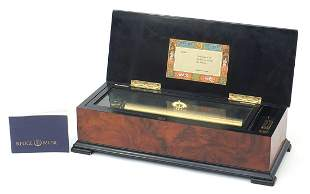 Reuge Music Sublime Harmonie music box housed in a burr