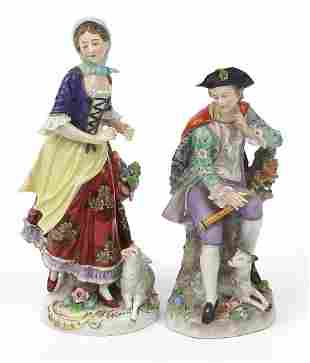 Pair of German porcelain figures with sheep, the