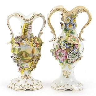 Two 19th century floral encrusted vases with twin