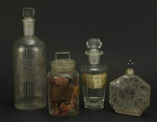 Four 19th century apothecary glass jars and an Art Deco