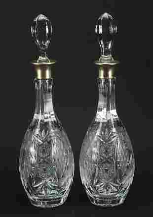 Pair of Mappin & Webb cut crystal decanters with silver