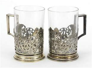 Pair of silver niello work cup holders, impressed