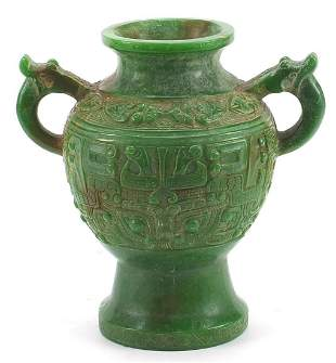 Chinese archaic style carved green jade vase with twin