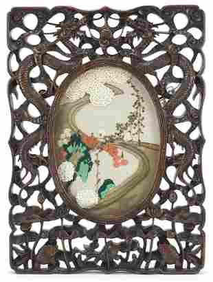 Chinese hardwood frame housing an embroidered panel,
