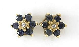 Pair of 9ct gold sapphire and diamond flower head stud