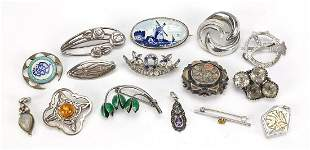 Antique and later silver brooches including paste and