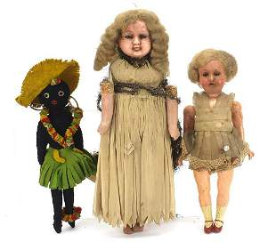 Three antique and later dolls comprising Armand