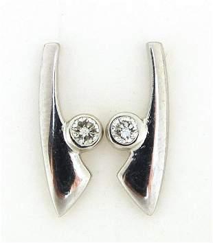 Pair of 9ct white gold diamond stud earrings, 1.6cm