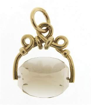 Antique design 9ct gold smoky quartz spinner fob, 2.5cm