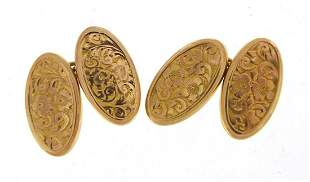 Pair of 9ct gold cufflinks with engraved decoration,