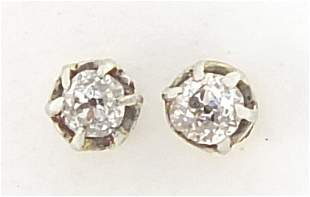 Pair of 9ct gold diamond solitaire stud earrings, 3mm