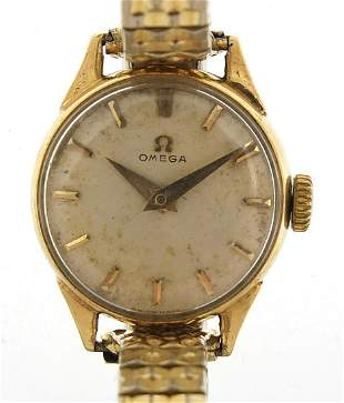 Omega, vintage ladies 9ct gold wristwatch housed in a J