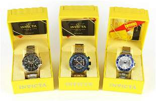 Three gentlemen's Invicta wristwatches with boxes and