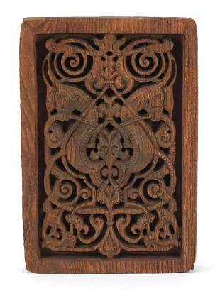 Turkish Islamic wooden panel carved with horseheads