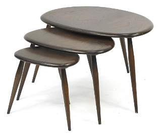Nest of three Ercol elm Pebble occasional tables, the