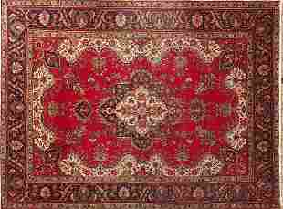Hand made Iranian carpet with stylised floral pattern
