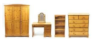 Pine bedroom suite comprising a triple wardrobe, five