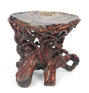 Chinese fluorite specimen tea table raised on a gnarled