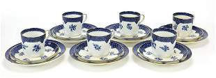 Set of six Coalport blue and white trios decorated with