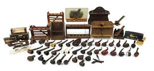 Collection of vintage smoking pipes and pipe racks,