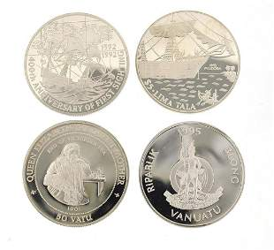 Four silver commemorative coins including Queen
