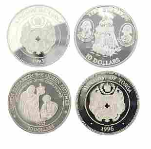 Four silver commemorative coins including two from