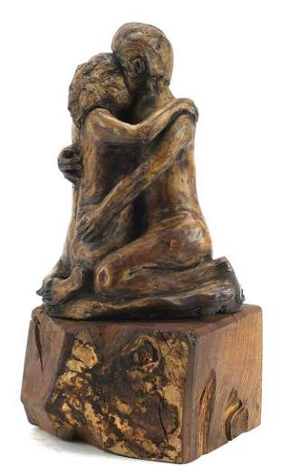 Modernist sculpture of two lovers raised on a