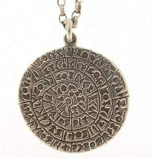 Silver Egyptian revival hieroglyphics medallion on a