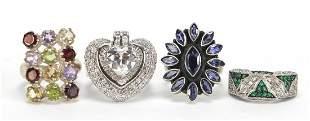 Four large silver semi precious stone rings, various