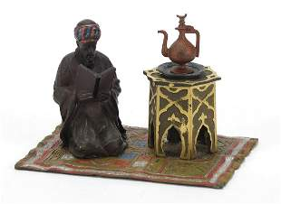 Cold painted bronze of a figure on a carpet in the