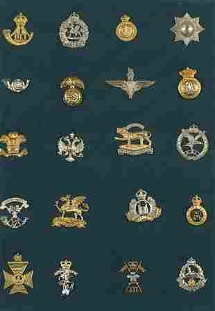 Framed glazed display of military interest cap badges
