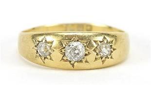 18ct gold diamond three stone Gypsy ring...