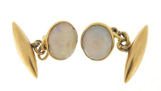 Pair of 18ct gold opal cufflinks, 1cm wi...