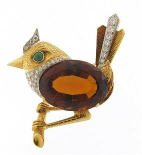 Good unmarked gold and citrine bird on a...