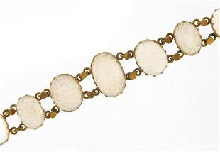 Antique unmarked gold cabochon graduated...