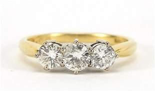 18ct gold diamond three stone ring, the ...