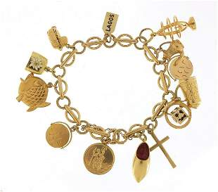 9ct gold charm bracelet with a selection...