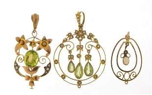 Three Art Nouveau gold pendants set with...
