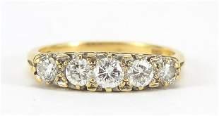 18ct gold diamond five stone ring, the c...
