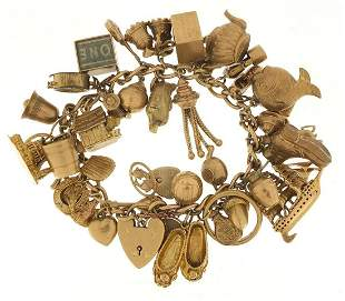 Good 9ct gold charm bracelet with a larg...