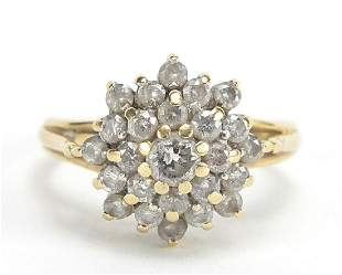 Unmarked gold diamond four tier cluster ...