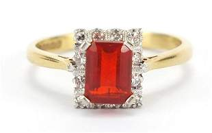18ct gold red stone and diamond ring, si...