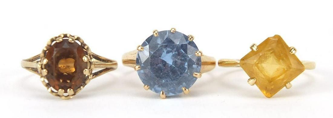 Three gold rings comprising 18ct gold wi...