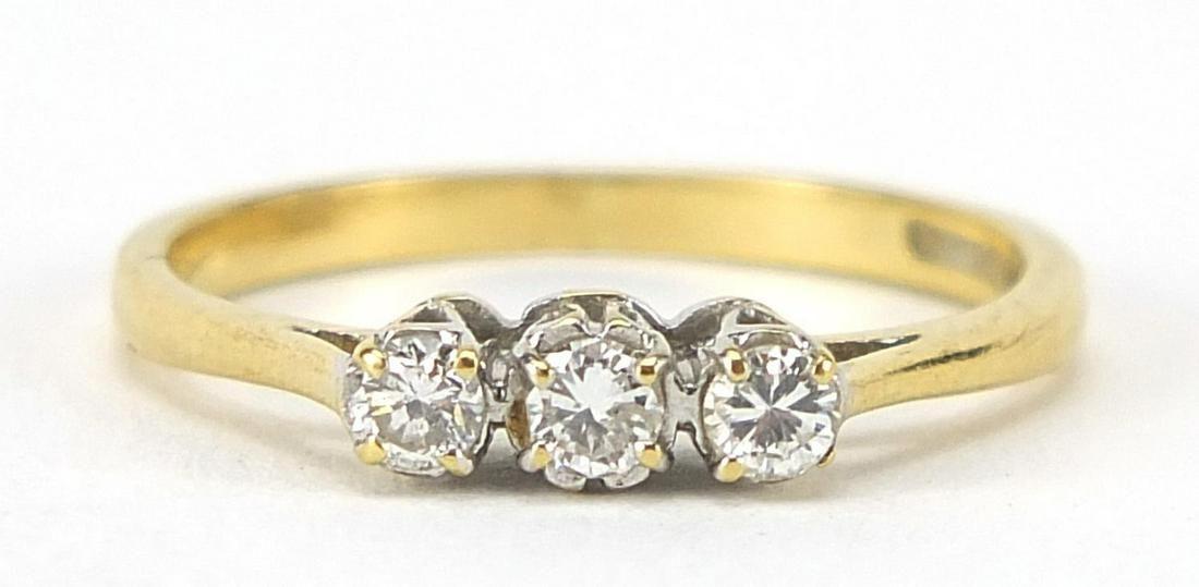 18ct gold diamond three stone ring, size...