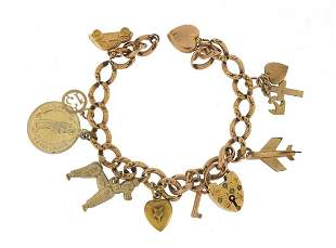 9ct rose gold charm bracelet with a sele...