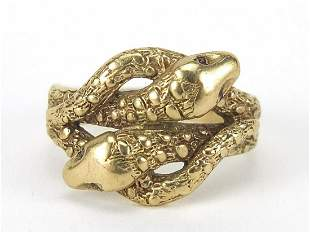9ct gold serpent ring with ruby eyes, st...